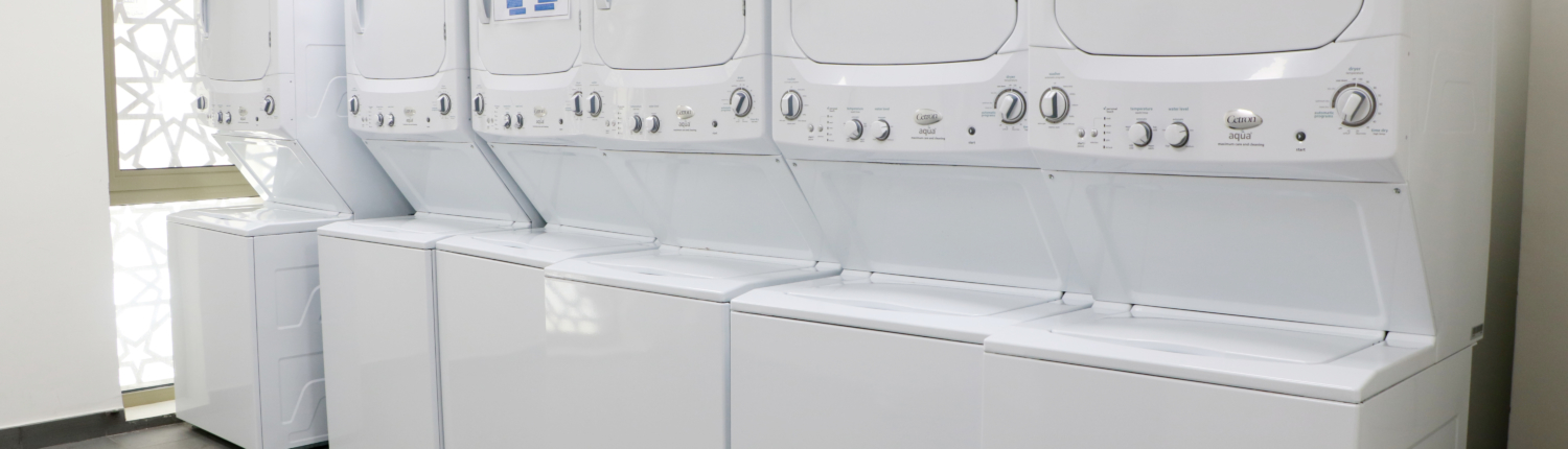 Laundry room in student housing  residences at GUtech campus, equipped with heavy duty washing and drying machines